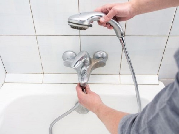 how to remove shower handle without screws